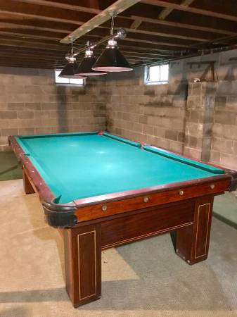 Vintage 9 X 5 V Loria Sons Pool Table With Original Ivory Cue Sticks And Rack Good Condition New Felt Overhead Lights Also Included